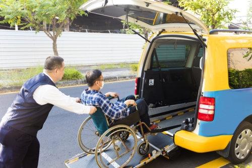 man helping a man in a wheelchair